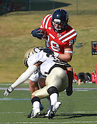 Samford tight end Zeke Walters is hit by  Wofford Josh Holt at Seibert Stadium in Homewood, Ala., Saturday, Oct 13, 2012. Samford defeats Wofford 24-17 in Overtime. (Marvin Gentry)