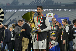 May 19, 2019 - Turin, Turin, Italy - Sami Khedira of Juventus FC lifts  the trophy of Scudetto  2018-2019 at Allianz Stadium, Turin (Credit Image: © Antonio Polia/Pacific Press via ZUMA Wire)
