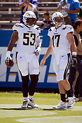 Los Angeles Chargers center Mike Pouncey (53) and Los Angeles Chargers quarterback Philip Rivers (17) look on as the pair takes a break from pregame warmups before the 2018 regular season week 1 NFL football game against the Kansas City Chiefs on Sunday, Sept. 9, 2018 in Carson, Calif. The Chiefs won the game 38-28. (©Paul Anthony Spinelli)