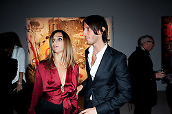 Carine Roitfeld and her son Vladimir Restoin Roitfeld at a private view of Nicolas Pol's paintings entitled 'Mother of Pouacrus' held at The Dairy, Wakefield Street, London WC1 on 14th October 2010.