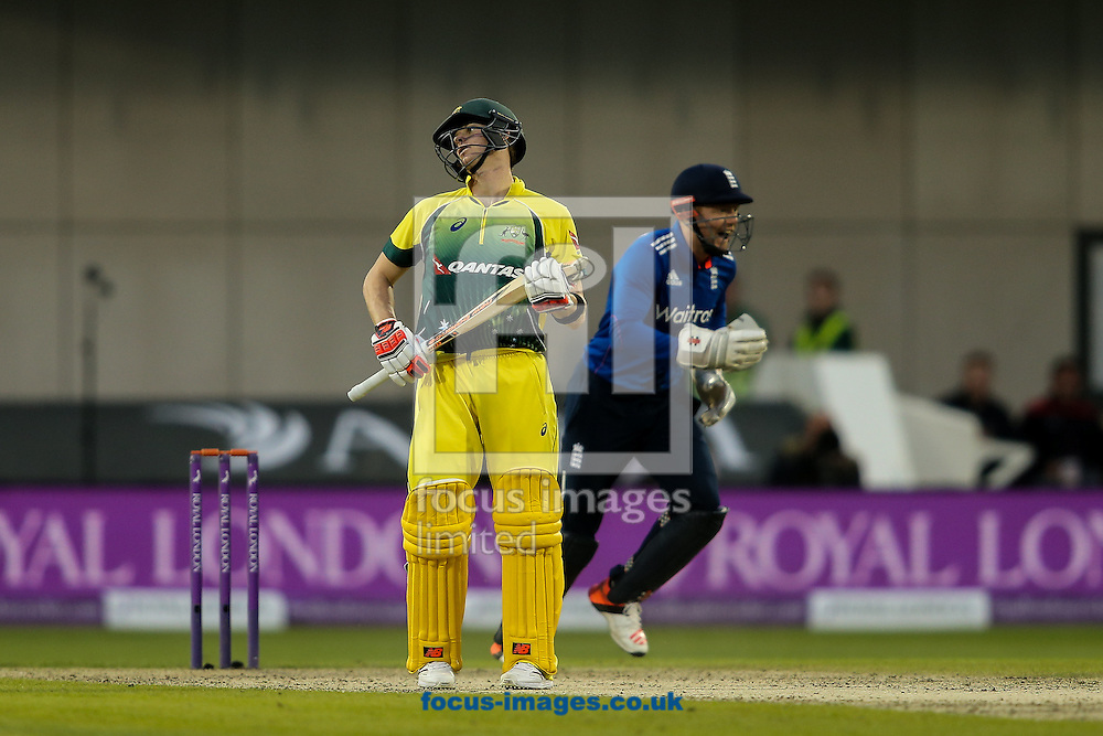 Steve Smith of Australia despairs after falling to a spectacular catch by Steven Finn of England (not shown) during the 3rd One Day International match at Old Trafford Cricket Ground, Stretford<br /> Picture by Andy Kearns/Focus Images Ltd 0781 864 4264<br /> 08/09/2015