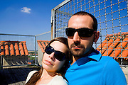lady on his shoulder with sunglasses