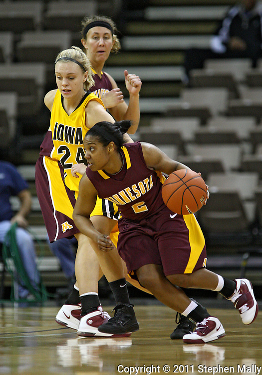 February 10 2011: Minnesota Golden Gophers guard China Antoine (2) drives around Iowa Hawkeyes guard Jaime Printy (24) during the first half of an NCAA women's college basketball game at Carver-Hawkeye Arena in Iowa City, Iowa on February 10, 2011. Iowa defeated Minnesota 64-62.