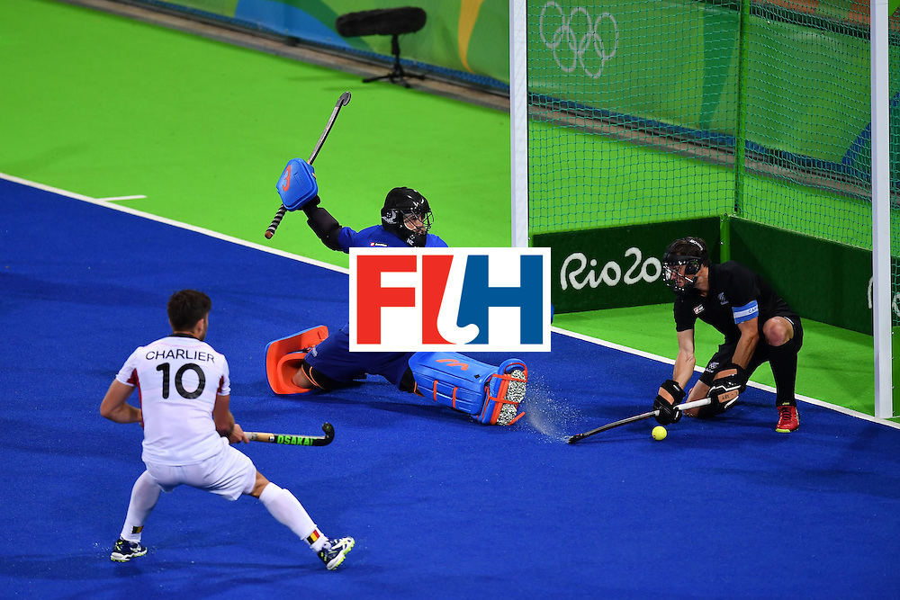 New Zealand's Devon Manchester (C) makes a save during the mens's field hockey Belgium vs New Zealand match of the Rio 2016 Olympics Games at the Olympic Hockey Centre in Rio de Janeiro on August, 12 2016. / AFP / MANAN VATSYAYANA        (Photo credit should read MANAN VATSYAYANA/AFP/Getty Images)