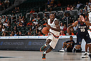 December 6, 2016: Davon Reed #5 of Miami in action during the NCAA basketball game between the Miami Hurricanes and the South Carolina State Bulldogs in Coral Gables, Florida. The 'Canes defeated the Bulldogs 82-46.