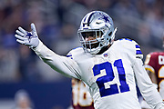 ARLINGTON, TX - NOVEMBER 22:  Ezekiel Elliott #21 of the Dallas Cowboys signals first down in the second half of a game against the Washington Redskins at AT&T Stadium on November 22, 2018 in Arlington, Texas.  The Cowboys defeated the Redskins 31-23.  (Photo by Wesley Hitt/Getty Images) *** Local Caption *** Ezekiel Elliott