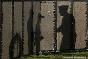"""Shadows on the wall.<br /> Day 3 of the """"Wall That Heals"""" Vietnam memorial. Late afternoon and evening at the wall.  ALL MODEL RELEASED BY SIGN BOARDS."""