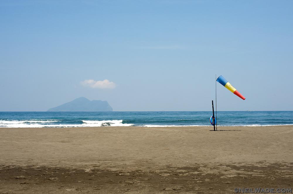 A windsock on an empty beach near Yilan, Taiwan.