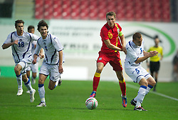 LLANELLI, WALES - Wednesday, August 15, 2012: Wales' captain Aaron Ramsey in action against Bosnia-Herzegovina's Boris Pandza during the international friendly match at Parc y Scarlets. (Pic by David Rawcliffe/Propaganda)