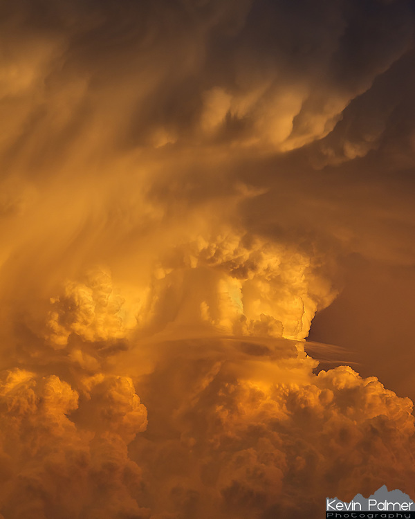 An updraft is a rising current of air that often leads to thunderstorms. The updraft of a developed storm is also the most active part with large raindrops and hailstones constantly rising and falling. As the rain and hail collide, this creates an electric field and eventually lightning. As the sun set, it gave this storm a beautiful orange color and highlighted the details and the structure.<br /> <br /> Date Taken: May 3, 2012