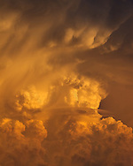 An updraft is a rising current of air that often leads to thunderstorms. The updraft of a developed storm is also the most active part with large raindrops and hailstones constantly rising and falling. As the rain and hail collide, this creates an electric field and eventually lightning. As the sun set, it gave this storm a beautiful orange color and highlighted the details and the structure.<br />