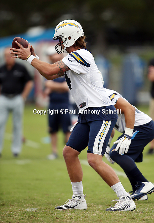 San Diego Chargers quarterback Zach Mettenberger (4) catches the snap in a shotgun formation during the Chargers 2016 NFL minicamp football practice held on Tuesday, June 14, 2016 in San Diego. (©Paul Anthony Spinelli)