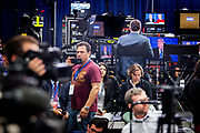 Reporters in the spin room listen to the debate. The Democrate and Republican nominees for US President, Hillary Rodham Clinton and Donald John Trump, met on Sep. 26th for the first head to head Presidential Debate at the Hofstra University in Long Island.