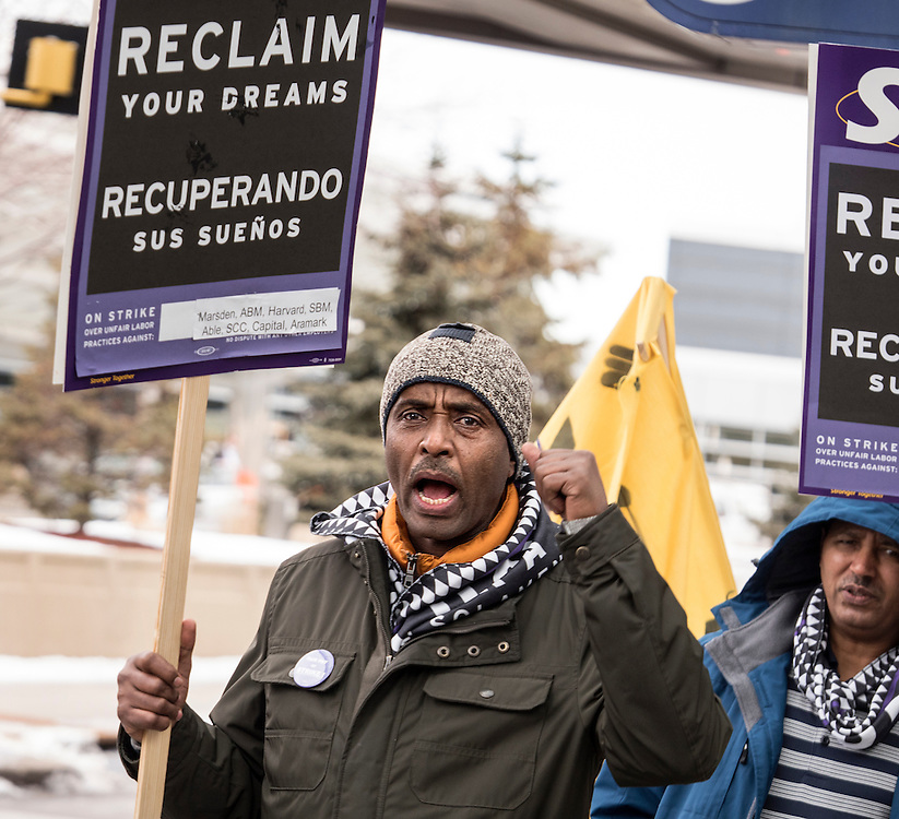 Hassan Kadir joins in a chant as Twin Cities janitors represented by Service Employees International Union picket for a wage increase at Minneapolis-St. Paul International Airport's Terminal 1 February 17, 2016.  The union is asking for $15 for both full and part-time workers.