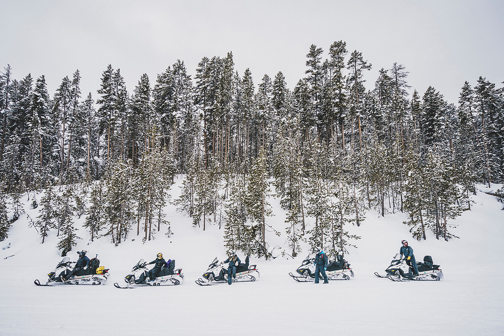 Terry Dolan, Jenna Spesard, Courtney Steeves, Tia Troy, and Brandon Eckroth out for a snowmobile tour of Yellowstone National Park, Wyoming.
