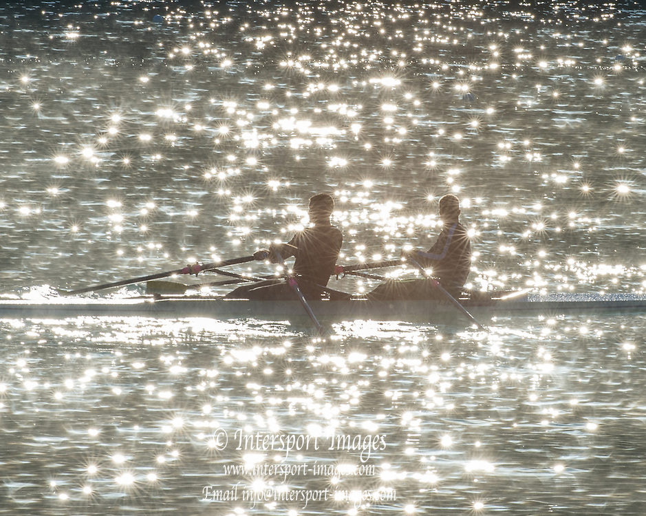 Aiguebelette, FRANCE,  Double scull, caught in the reflection of the water creating spectral high lights   2015 FISA World Rowing Championships, Venue, Lake Aiguebelette - Savoie. <br />