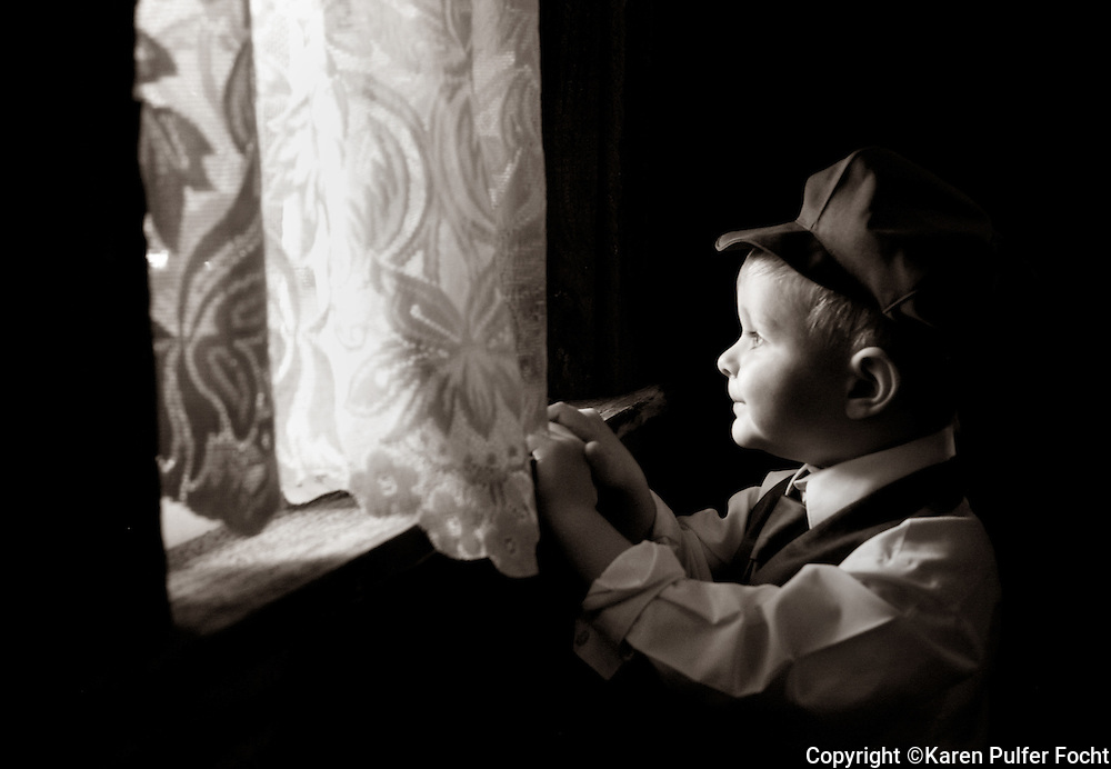A young ring bearer waits to be called to duty during a wedding in Central Illinois over Labor Day weekend.