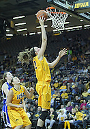 December 20, 2011: Iowa Hawkeyes center Morgan Johnson (12) puts up a shot during the NCAA women's basketball game between the Drake Bulldogs and the Iowa Hawkeyes at Carver-Hawkeye Arena in Iowa City, Iowa on Tuesday, December 20, 2011. Iowa defeated Drake 71-46.