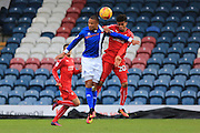 Joe Thompson and Darnell Furlong challenge for the ball during the EFL Sky Bet League 1 match between Rochdale and Swindon Town at Spotland, Rochdale, England on 19 November 2016. Photo by Daniel Youngs.
