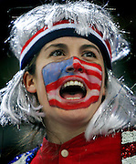 U.S. Women's Hockey Team fan Sally Maloney (cq), 27, of Boston, Ma. cheers as the U.S. Team is introduced before playing Finland during the  bronze medal game at the Palasport Olimpico in Turin, Italy on Monday February 20, 2006. The U.S. went on to win the bronze medal beating Finland 4-0. Maloney said she played women's hockey at Harvard..(MARC PISCOTTY/ROCKY MOUNTAIN NEWS) CQ Sally Maloney