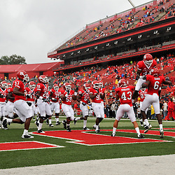 Sep 12, 2009; Piscataway, NJ, USA;  Rutgers wide receiver Mohamed Sanu (6) is joined by his teammates during warmups before Rutgers' 45-7 victory over Howard in NCAA College Football at Rutgers Stadium.