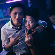 Bangkok, April 7, 2017 - Honeymoon Tomboy Club RCA<br /> Thailand's 'tom' (as in tomboys) inhabit a unique place on the gender spectrum. They are girls who dress and act in a masculine way, typically sporting a uniform look of short hair, t-shirts and jeans. But toms don't consider themselves trans or even lesbians, despite the fact that they date women (often girly 'dees' or other toms). <br /> <br /> You can&rsquo;t choose how you&rsquo;re born, but you can choose how to live your life. Thailand seems to be the most tolerant place for the LGBTI (lesbian, gay, bisexual, transgender, intersex ) community. However, tolerance doesn&rsquo;t mean acceptance. For the LGBTI people who have already revealed their gender identity tend to often be the ones that have been mistreated by the general public and the media due to the lack of knowledge and understanding. In Thai society, transmen are still in the shadow of &lsquo;tomboy&rsquo; culture. While the terms of &lsquo;transwoman&rsquo; and &lsquo;tomboy&rsquo; have been well known among Thai people for many decades, the term of &lsquo;transman&rsquo; only been introduced about 5 years ago. &ldquo;Phu Chai Kham Phej&rdquo; is a Thai term that has been translated from a western term &lsquo;transman&rsquo; which means a transgender person who was assigned female at birth but whose gender identity is that of a man. &copy; Jean-Michel Clajot