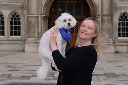 © Licensed to London News Pictures. File picture dated 20/02/17. Gabby (Gabrielle) Kuehn with Vinnie the dog outside at the Mayor's and City of London court in London on 20th February 2017. An appeal hearing at the High Court has been brought by the Kuehn's against the blanket no pet policy clause in the leasehold agreement issued by their property management company, Victory Place. The appeal follows a previous hearing at the Mayor's and City of London magistrates court held in February 2017 when Victory Place Management Company brought and won an action to evict the couples dog, Vinnie, a Maltese-Yorkshire terrier cross. The Kuehn's have appealed against the original judgement and are challenging the legality of blanket no pet policies in leasehold contracts. Victory Place Management Company have lodged a counter appeal. Photo credit: Vickie Flores/LNP