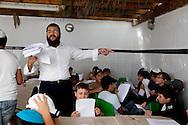 Morocco, Casablanca - soukoth fest, young jewish boys, in the souka. the jewish girls school, lubavitch  Ohale Yosseg Ytshak oufaratsta .  /  fete de soukoth . fete des cabanes , jeunes garcons dans la souka , ecole loubavitch , casablanca, maroc / +
