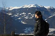 Italy, Friuli-Venezia Giulia, San Leonardo A woman admiring the view of the Alps Model Release Available