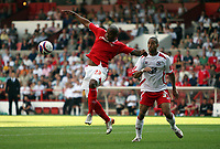 Photo: Rich Eaton. <br /> <br /> Nottingham Forest v AFC Bournemouth. Coca Cola Championship. 11/08/2007. Forest's Junior Agogo (l) jumps for the ball ahead of Bournemouth's Ryan Garry (r).