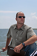 Michael Burne, the executive director of the Sierra Club on a boat  out in Barataria Bay to see the BP oil spill in person.