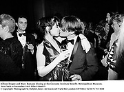 Allison Draper and Marc Romano kissing at the Costume Institute benefit. Metropolitan Museum. New York. 6 December 1993. Film 93204f15<br />&copy; Copyright Photograph by Dafydd Jones<br />66 Stockwell Park Rd. London SW9 0DA<br />Tel 0171 733 0108