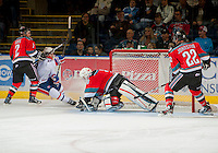 KELOWNA, CANADA - OCTOBER 10: Jordon Cooke #30 of the Kelowna Rockets makes a save on a shot by Blake Gal #10 of the Spokane Chiefs as Jesse Lees #2 of the Kelowna Rockets checks Gal  as the Spokane Chiefs visit the Kelowna Rockets on October 10, 2012 at Prospera Place in Kelowna, British Columbia, Canada (Photo by Marissa Baecker/Shoot the Breeze) *** Local Caption ***