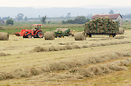 Florida, NY - A  farmer on a tractor moves bales of hay out of a field on July 11, 2008.