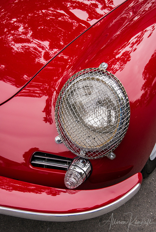 Detail of a vintage red Porsche on display at the 2017 Carmel-by-the-Sea Concours on the Avenue