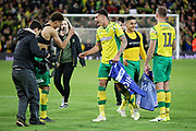 Norwich City midfielder Ben Godfrey (4)  and Norwich City defender Jamal Lewis (12)  celebrate after the EFL Sky Bet Championship match between Norwich City and Blackburn Rovers at Carrow Road, Norwich, England on 27 April 2019.
