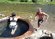 "Jerily McCormick and her husband Ron of Penn, Valley, CA enjoy the ""Boat Box"" geothermal hot springs on Saturday July 13th, 2013 along the Salmon River adjacent to Idaho Highway-75 north of Stanley, ID in the Sawtooth Mountains."