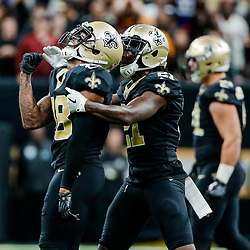Nov 19, 2017; New Orleans, LA, USA; New Orleans Saints safety Vonn Bell (48) celebrates with cornerback De'Vante Harris (21) after a sack and forced fumble against the Washington Redskins during the second half of a game at the Mercedes-Benz Superdome. The Saints defeated the Redskins 34-31 in overtime. Mandatory Credit: Derick E. Hingle-USA TODAY Sports