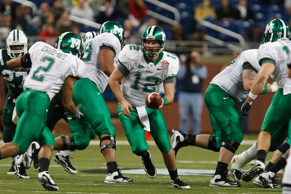 December 26, 2009: Marshall's Brian Anderson (12) hand off to Terrell Edwards-Maye (2)  during the NCAA: Little Caesars Pizza Bowl - Ohio vs Marshall at Ford Field Detroit, Michigan. Marshall defeater Ohio 21-17.