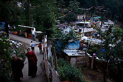 Monks make their way through town of McLeod Ganj, Dharamsala, India, where the Dalai Lama settled after fleeing Tibet in 1959 after a failed uprising against Chinese rule, June 1, 2009.