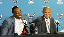 June 26, 2017 - Charlotte, NC, USA - Charlotte Hornets center Dwight Howard jokes with General Manager Rich Cho during a news conference on Monday, June 26, 2017 at the Spectrum Center in Charlotte, N.C. Howard poked fun at Cho about his slip of the tongue on Friday when he introduced draft pick Dwayne Bacon as Dwyane Wade. (Credit Image: © David T. Foster Iii/TNS via ZUMA Wire)