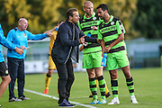Forest Green Rovers manager, Mark Cooper gives instructions to Forest Green Rovers Fabien Robert (26) during a break in play during the Vanarama National League match between Forest Green Rovers and Sutton United at the New Lawn, Forest Green, United Kingdom on 9 August 2016. Photo by Shane Healey.