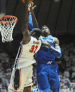 """Kentucky's Nerlens Noel (3) defends Mississippi's Murphy Holloway (31) at the C.M. """"Tad"""" Smith Coliseum on Tuesday, January 29, 2013. Noel had 12 blocks as Kentucky won 87-74. (AP Photo/Oxford Eagle, Bruce Newman).."""