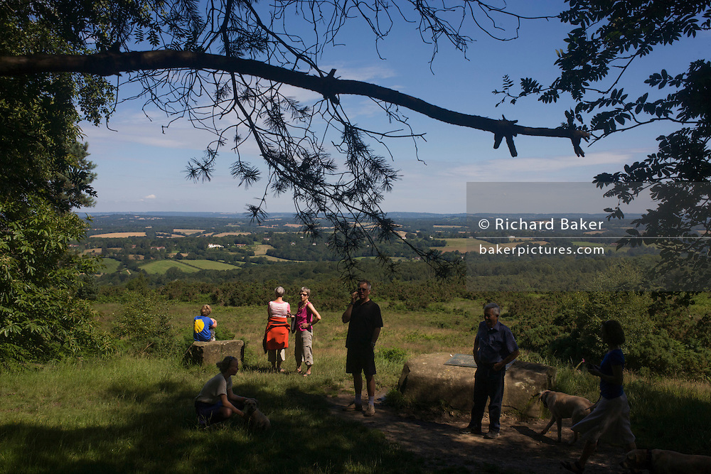 Walkers gather at Gills Lap a high point in Ashdown Forest of 1600 hectares of Heathland, used as AA Milne's Winnie the Pooh 100 Acre Wood.
