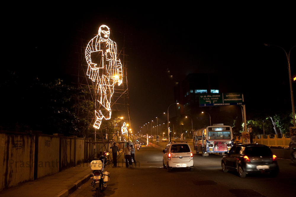 A lit installation depicting Chief Minister, M. Karunanidhi is seen on a main road in Chennai, India, on Thursday, January 13, 2011. Karunanidhi began his career as a screenwriter in the Tamil film industry. Through his wit and oratorical skills he rapidly rose as a popular politician. He was famous for writing historical and social (reformist) stories which propagated the socialist and rationalist ideals of the Dravidian movement to which he belonged.  Photographer: Prashanth Vishwanathan/HELSINGIN SANOMAT