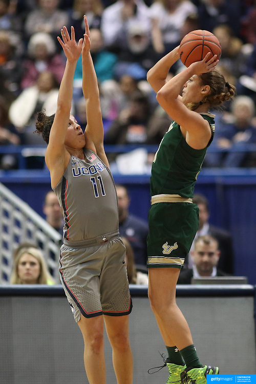 HARTFORD, CONNECTICUT- JANUARY 10: Ariadna Pujol #11 of the South Florida Bulls shoots while defended by Kia Nurse #11 of the Connecticut Huskies during the the UConn Huskies Vs USF Bulls, NCAA Women's Basketball game on January 10th, 2017 at the XL Center, Hartford, Connecticut. (Photo by Tim Clayton/Corbis via Getty Images)