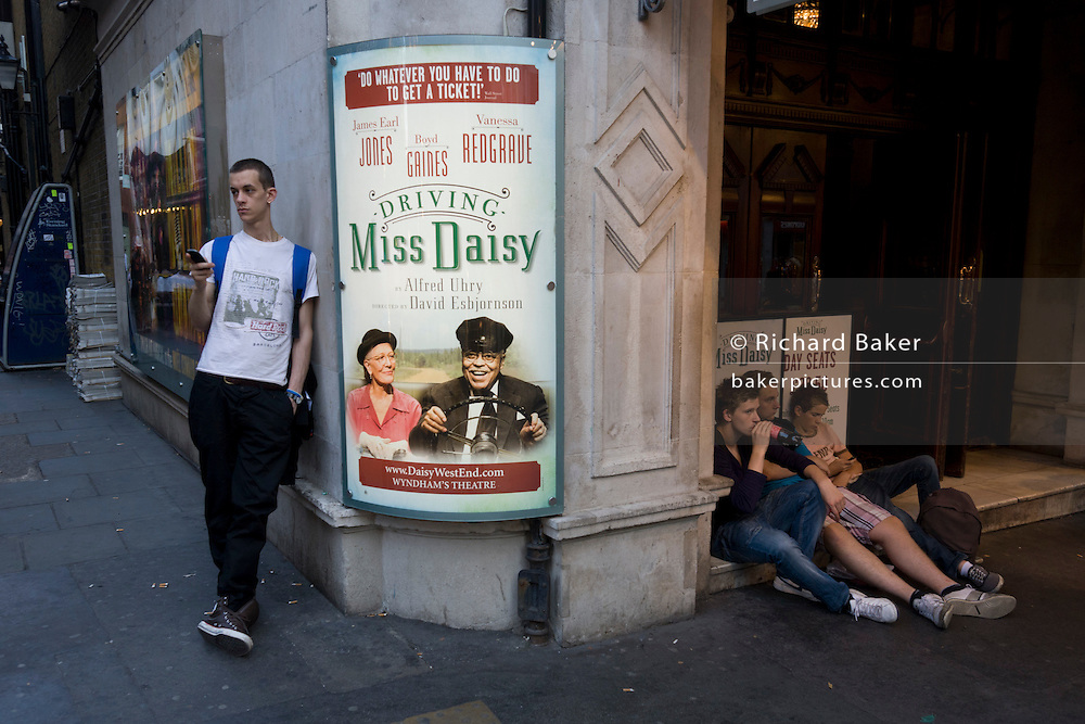 Youths hang around London's Wyndham's Theatre where the play 'Driving Miss Daisy' with Vanessa Redgrave is playing. Driving Miss Daisy is a 1989 American comedy-drama film adapted from the Alfred Uhry play of the same title. Driving Miss Daisy is a 1989 American comedy-drama film adapted from the Alfred Uhry play of the same title. The story defines Daisy and her point of view through a network of relationships and emotions by focusing on her home life, synagogue, friends, family, fears, and concerns.