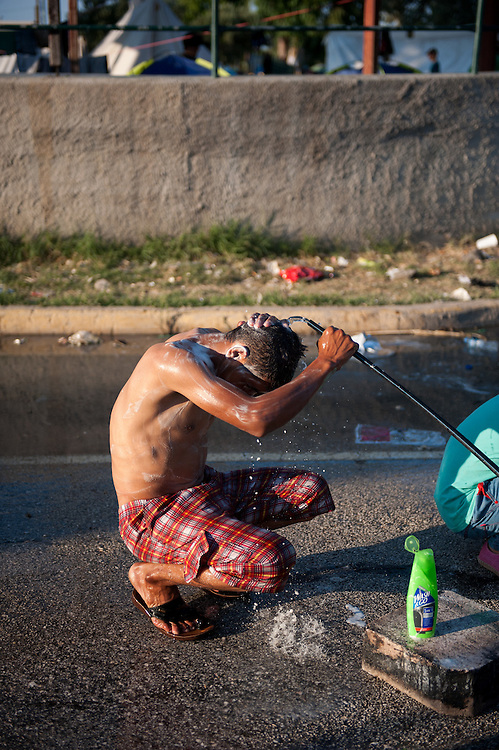 Moshed from Afghanistan having a shower in Kara Tepe camp. He has been in the camp 3 days.