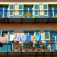 Drying Laundry and Flower Pots on Terraces in Nice, France<br /> Since 350 BC, the town of Nice along the Mediterranean coast in southeast France has been a haven for royalty, aristocrats, artists, the ultra-rich and millions of tourists a year.  But it is also home to about one million people, some who decorate their cramped terraces with flower pots while using them to air dry their laundry.