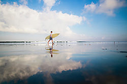Surfer on Kuta Beach, Bali, Indonesia, Southeast Asia